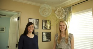 Amy and Chelsea with completed yarn chandeliers.