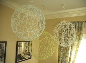 Yarn chandeliers hanging from ceiling.