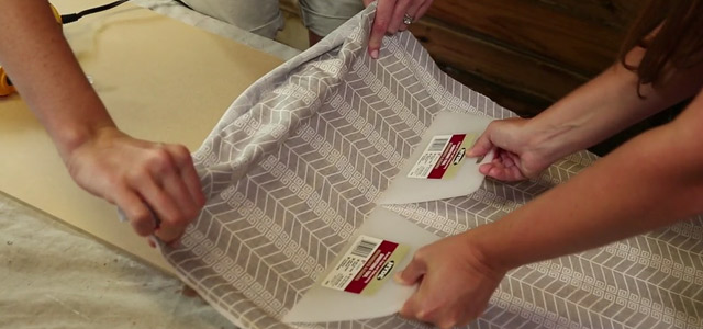 Attaching fabric to MDF with hot glue.