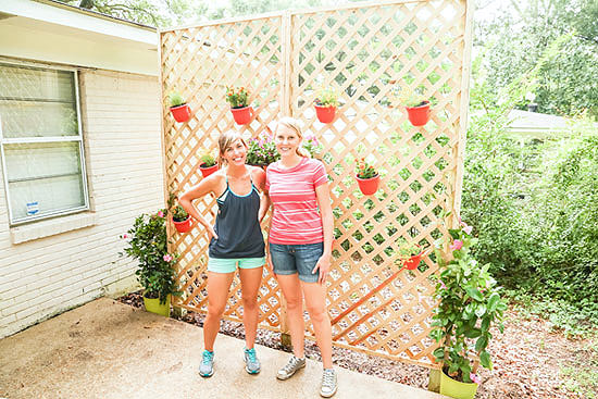 Laura and Chelsea with Completed Privacy Lattice Wall Project