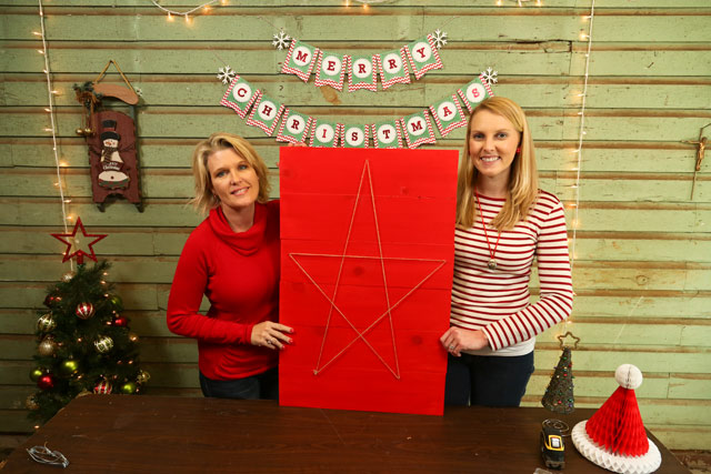 Kathy and Chelsea holding completed red Christmas card holder with string star