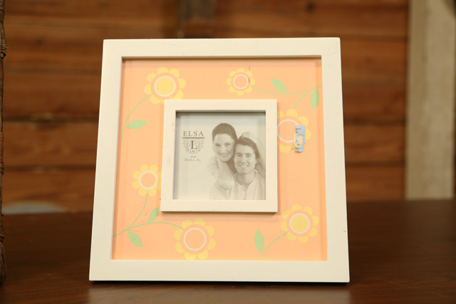 picture frame with orange flowers and white frame
