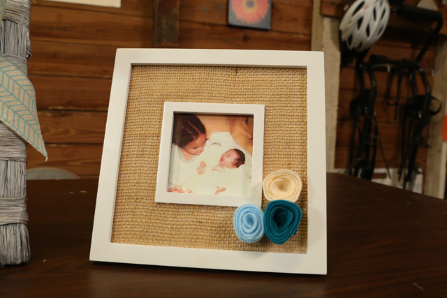 white picture frame with burlap and blue felt flowers