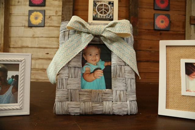 white washed woven frame with ribbon bow on top
