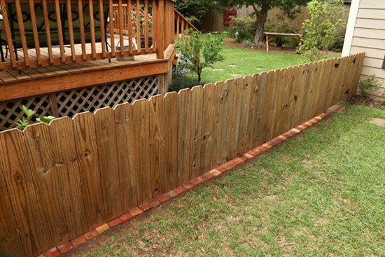 Bricks Under Wood Picket Fence