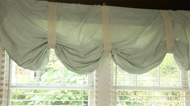 light blue no-sew valance curtain over white windows