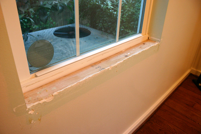 vinyl window with stool or apron removed
