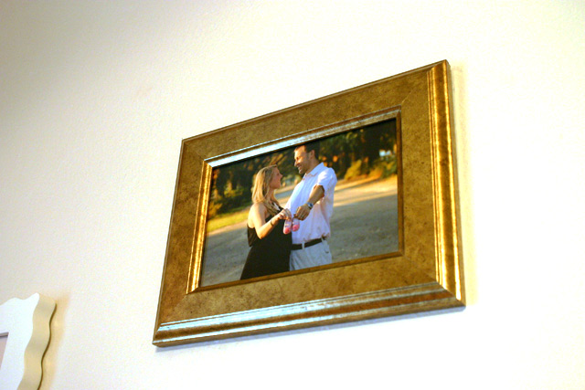 gold frame with husband and wife maternity photo it's a girl