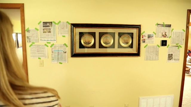 newspaper templates for photo frames taped on wall for framed gallery wall
