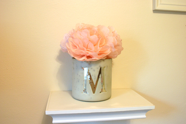 pink peonies in mercury glass vase on white shelf