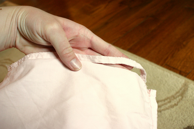 pink fitted sheet cut seam at corners