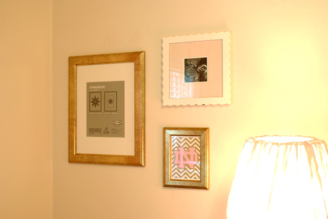 large gold frame, small gold frame, and square white frame hanging on cream white walls