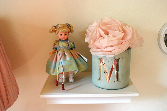 jumping rope madame alexander doll on floating shelf with tissue paper pink flowers