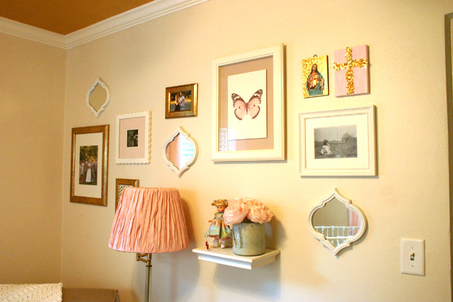pink, gold and white gallery wall frames and shelf