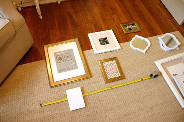 tape measure picture frames on floor for gallery wall hanging