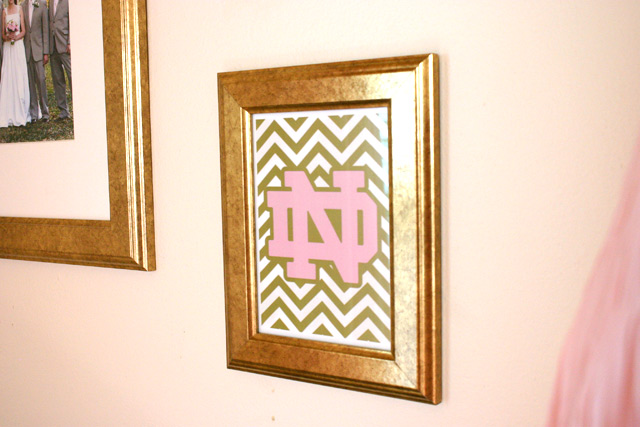 Fancy notre dame logo in pink gold chevron stripes gold picture frame