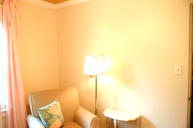 nursery wall with lamp shade tan glider chair and white end table