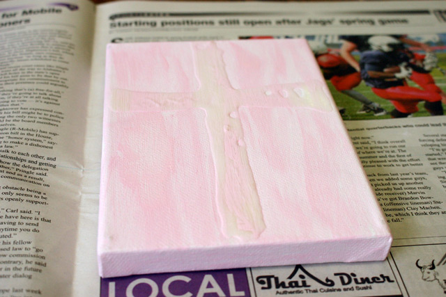 streaky pink acrylic paint on small canvas