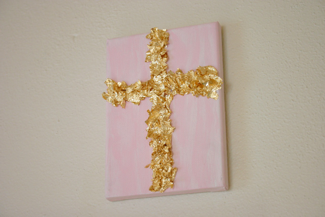 Pink Canvas With Gold Leaf Cross Hanging On Wall