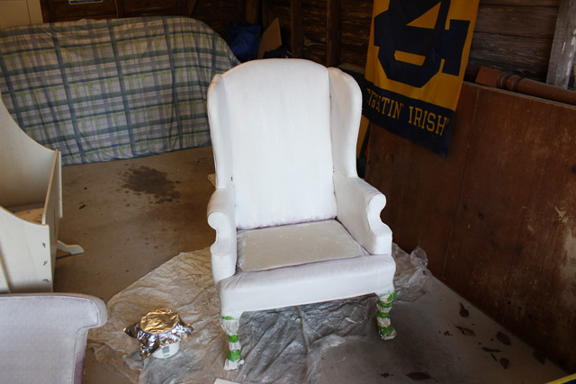 armchair being painted white in garage shop