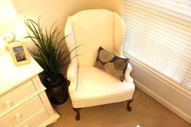 wingback armchair painted white in corner of bedroom