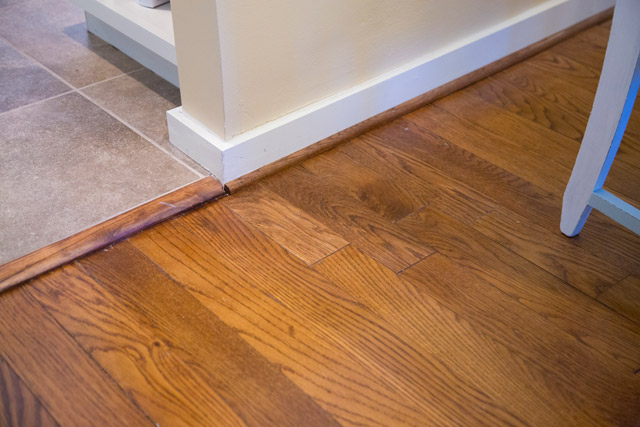 hardwood floor seamless patch near tile floor