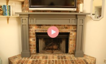 gray fireplace mantel over brick fireplace hearth