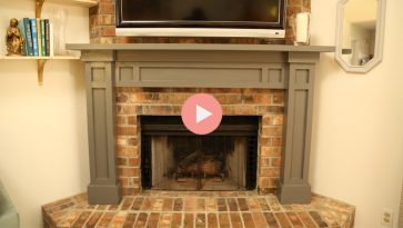 gray fireplace mantel over brick fireplace hearth