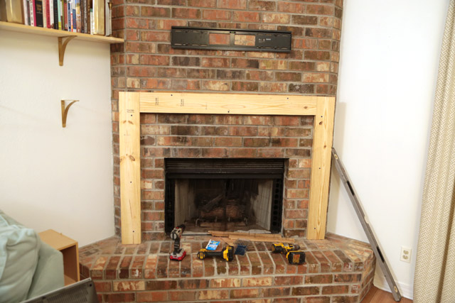 Step-by-step how-to instructions building a wooden fireplace mantel from scratch over existing brick fireplace. Only power tools needed are circular saw & drill