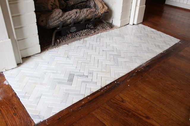 white and gray marble herringbone tile fireplace hearth