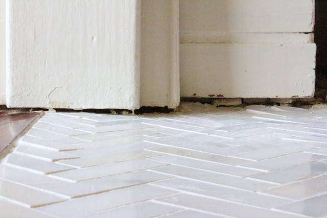 gap under white mantel leg fireplace marble hearth tile