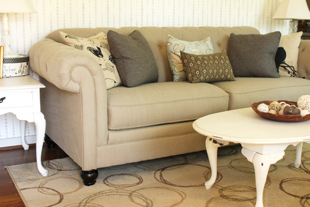 tan tufted sofa in living room