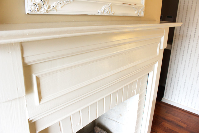 white fireplace mantel with decorative molding