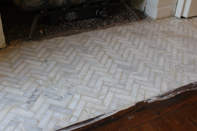 white and gray herringbone tile with alabaster grout