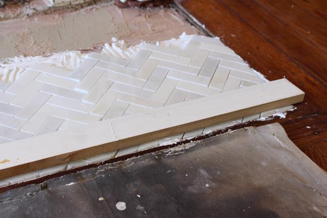 Using Straight Edge to Flush Tiles