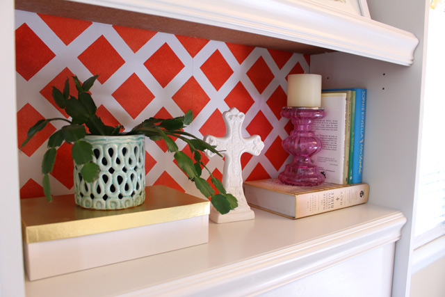 Bookshelf with Red Pattern Background