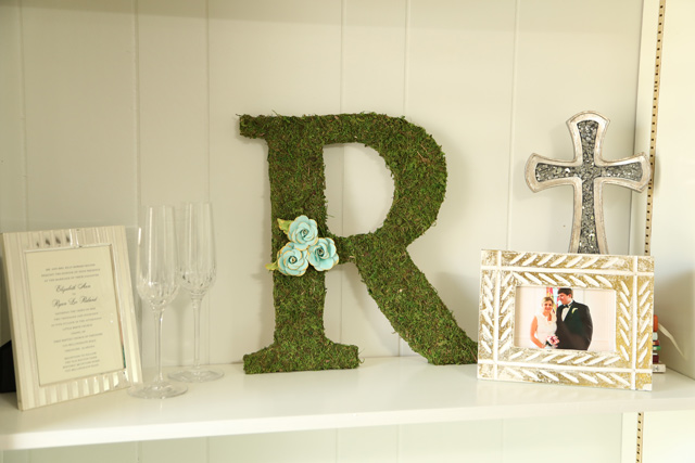 Moss Covered Initial on Bookshelf