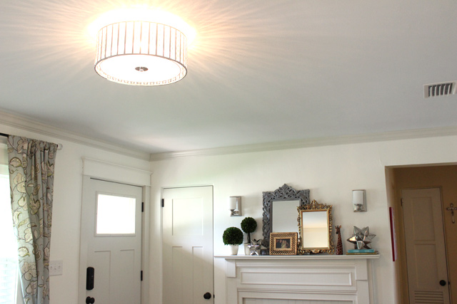 Beaded Flush Mount Light Fixture Installed In White Living Room