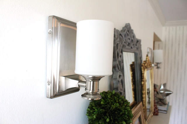 brushed nickel urban light wall sconce installed on white plaster wall