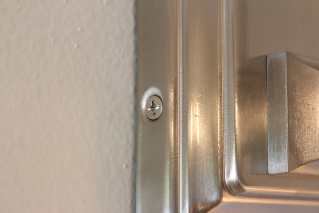 brushed nickel wall sconce set screw in place