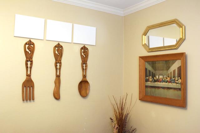 Hanging Art Utensils In Dining Room