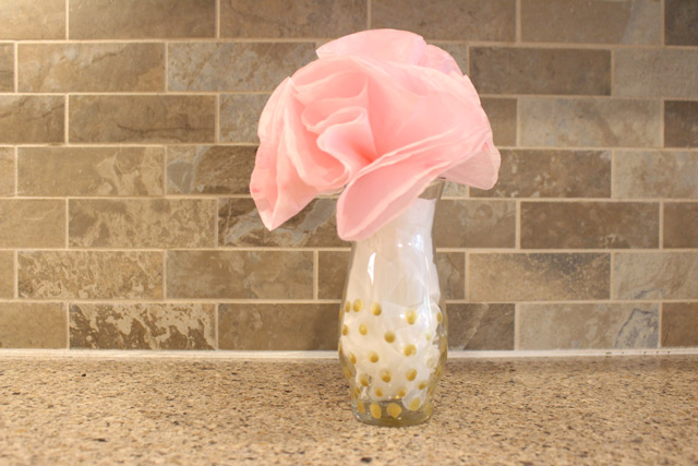 pink paper flowers in glass vase with gold polka dots