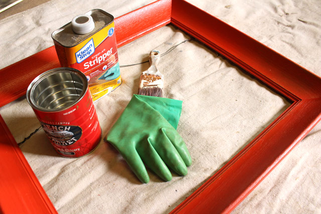 metal coffee can, chemical gloves, chemical stripper, paint brush, red wooden frame