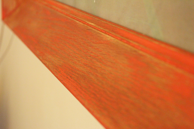 red stained wooden frame close up