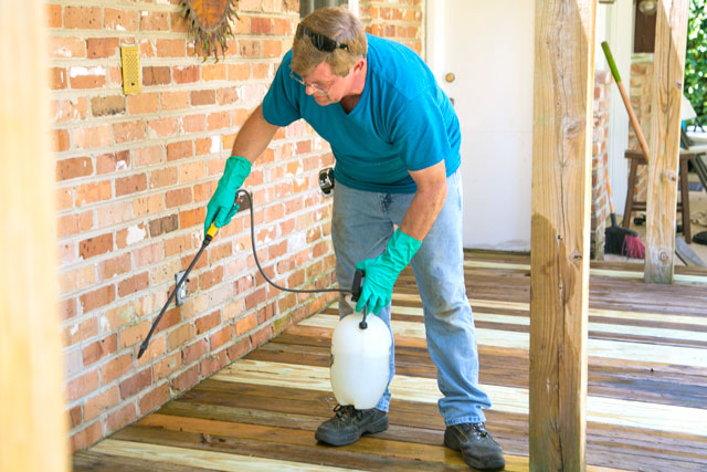 Allen Applying Wood Cleaner to Old Deck Boards