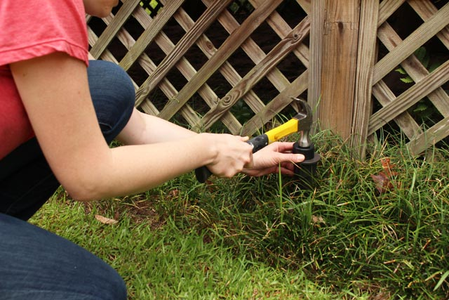 hammering light fixture plastic stake into ground