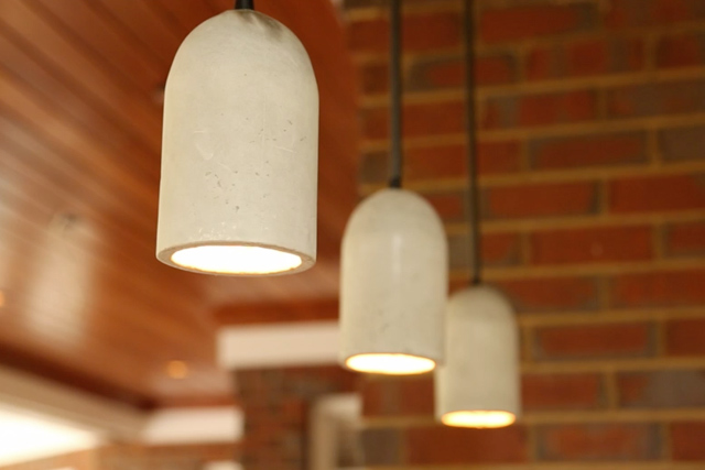 completed concrete pendant lights made from quieter sand/topping mix and soda bottles