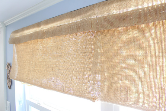 DIY Roman Shades Hanging in Windows