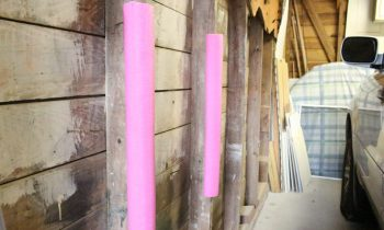 pink pool noodles attached to garage studs to protect car door