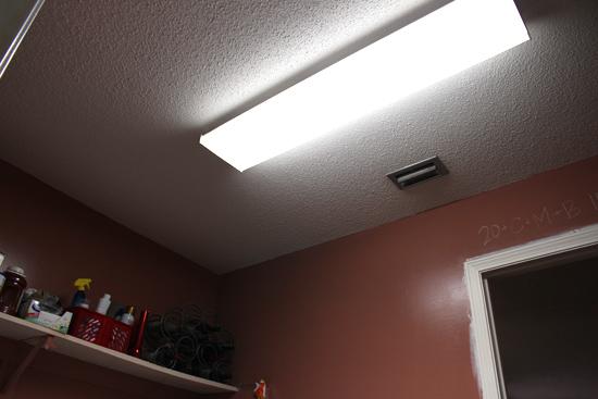 Fluorescent Light Fixture Hanging in Laundry Room